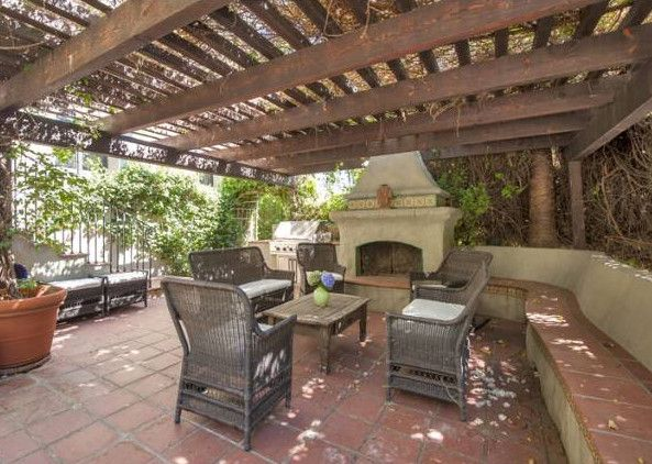 Consider a bench around the exterior to accomodate larger gatherings and utilize regular patio seating for smaller groups. Cushions can be made to fit the bench seating.