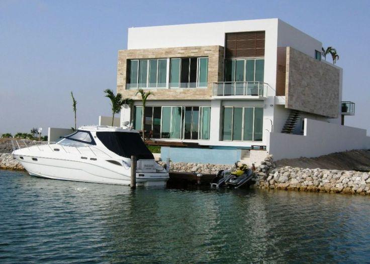 Vivir en la playa jamás será tan chic y divertido como en esta casa en venta en Puerto #Cancún UC69-2 #BienesRaíces #CostaRealty