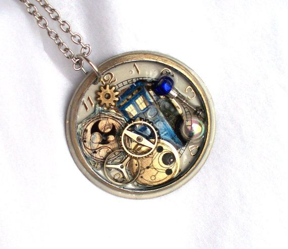 This unique steampunk necklace is handcrafted from an antique pocket watch face (approx 1.75 across) that has been imprinted with the Tardis