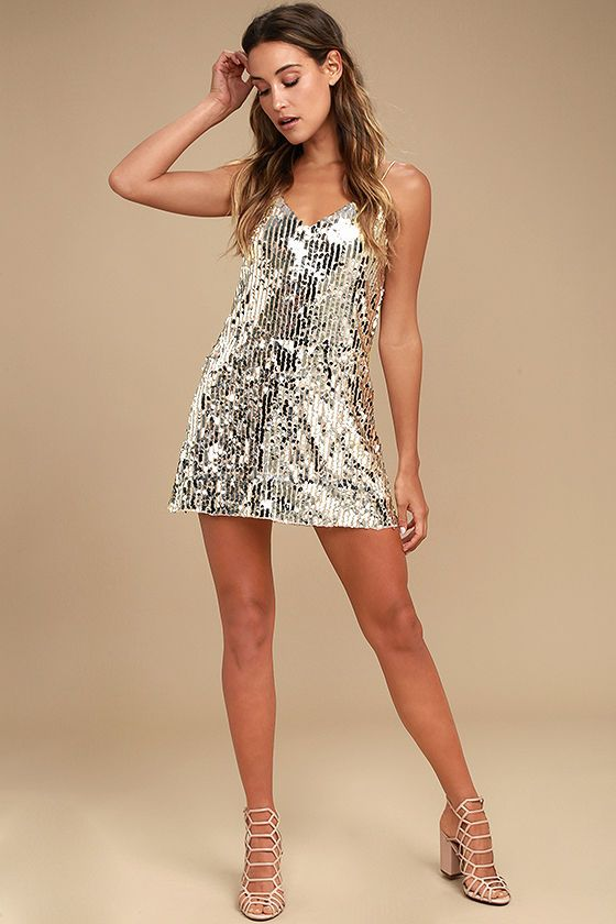 Steal the show wherever you go in the Shine Art Silver Sequin Mini Dress! Shimmering silver and rose gold sequins dazzle across triangle bodice and shift silhouette that ends at a leg-baring length. Skinny straps.