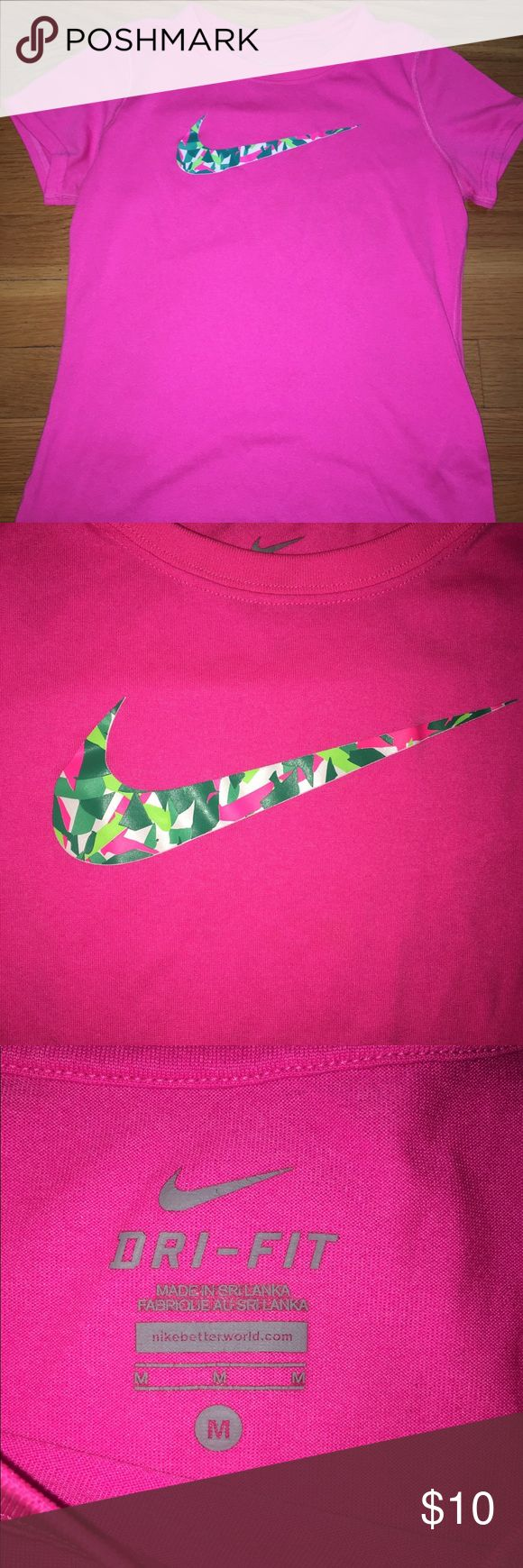 Girls Nike Short Sleeve Dryfit Shirt This Is a Girls Nike dry-fit short sleeve shirt! It's a pink short sleeve shirt with the Nike logo on the middle of the shirt on the front side! The Nike logo has green, light green, pink, and white geometrical features within it. This shirt is a side medium (M) in the girls department! NOT women! This shirt is also dry-fit, not cotton. Hope you like it! ❤️ Nike Shirts & Tops Tees - Short Sleeve