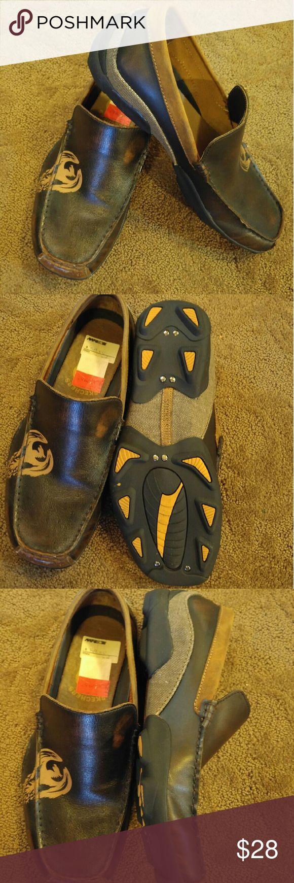 "Men's Skechers slip on shoe Skechers ""Socks Suck"" canvas and leather slip on men's shoe.  Never worn. Skechers Shoes Loafers & Slip-Ons"