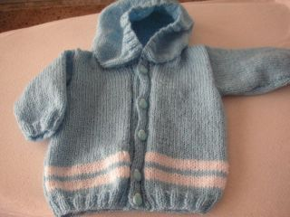This is the most straighforward pattern I have found so far for a cardigan/hoody.  I want to knit one for my 2 year old nephew in time for autumn so I had better make my mind up soon on which pattern to choose.  For a boy I think this would be nice in a denim blue colour.