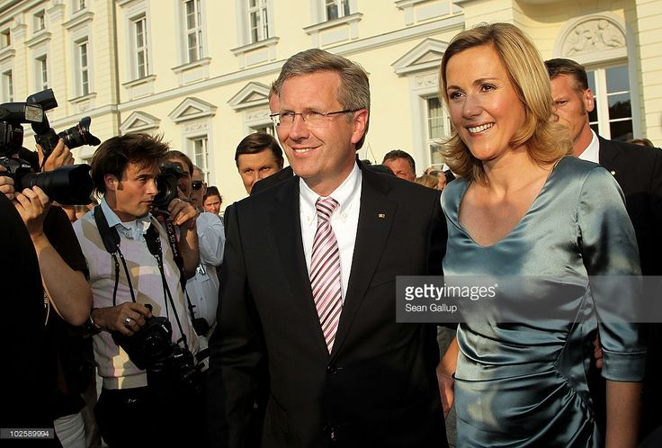 Newly-elected German President Christian Wulff and his wife First Lady Bettina Wulff attend the President's annual summer garden party at Schloss Bellevue on July 2, 2010 in Berlin, Germany. The party was Wulff's first official event as president following his confirmation ceremony earlier in the day.