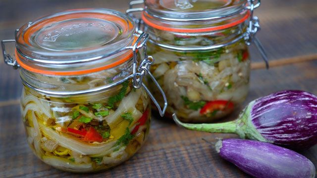 This Pickled Eggplant recipe is a traditional Italian recipe from Kitchen Vignettes. It features hot red pepper, garlic, and olive oil.
