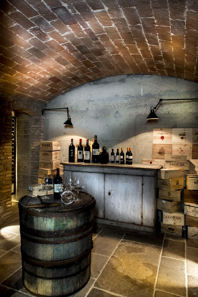 Not sure if this is a painting or an actual space but it looks magnificent. I think this is an old world wine room with original wine boxes from Italy scattered about.