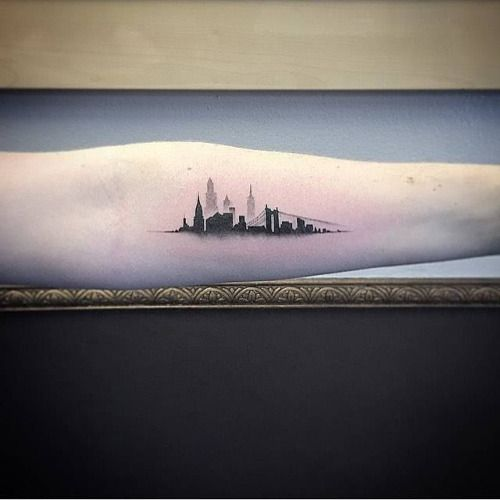 Single needle New York skyline tattoo on the left inner forearm....