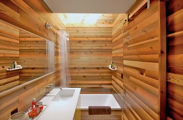 Japanese Bath House Inspired Bathroom - asian - bathroom - portland - Right Arm Construction Use natural light and materials to create a neutral color palette, whether it's dark tiles to encourage introspection or light, caramel-colored cypress tubs that give off a fresh aroma and, unlike a chilly porcelain tub, won't send icy shivers down your spine when you rest your head on the rim.