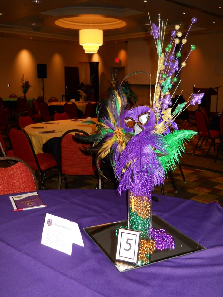 Purple gold and green party decorations our client used