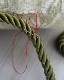 Sew around the pillow, then insert the cord end into the opening, and stitch closed.