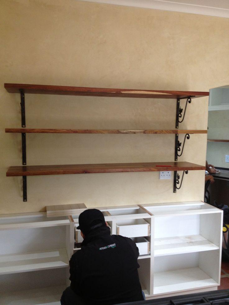 Kiaat wooden shelves installed on hand forged iron brackets