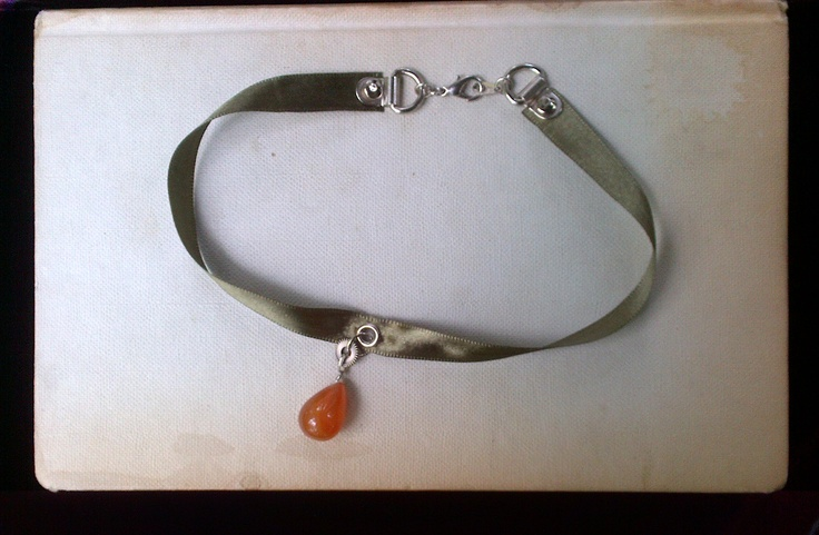 Olive green satin ribbon  Cog  Carnelian drop  Silver lace-holders  Silver rivets  Silver eyelet
