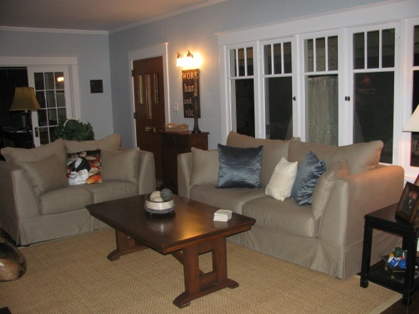 blue craftsman living room with khaki couch