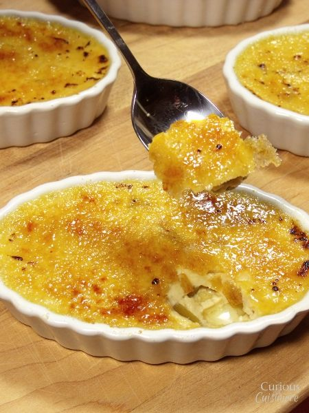This Mango Creme Brulee is a sweet and delicious treat! The best part is the perfectly caramelized golden crust! Recipe by Curious Cuisine.
