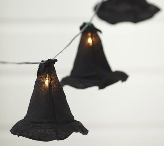 12 halloween decorating ideas from bh witches hats string lights from pottery barn but would probably be an easy diy