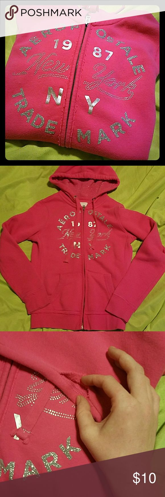 Aero zip up hoodie Pink zip up hoodie with glitter and stud bling there is a small opening under left arm (pic 3) where the seam has come apart I would fix it but I'm not handy like that other than that it's in great condition Aeropostale Tops Sweatshirts & Hoodies