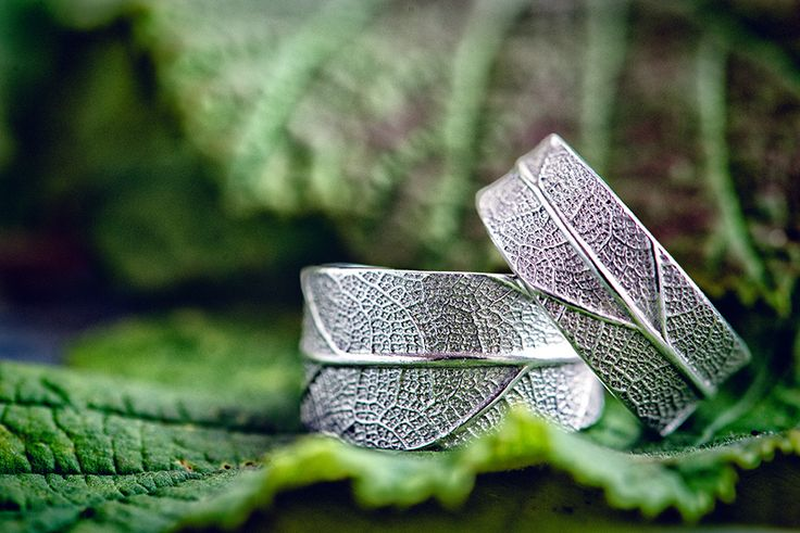 Wedding rings with a real leaf imprint. Photographed at Folly Farm Wedding, Pensford, Bristol