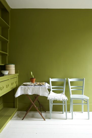 Green Wall Color. Perfect Place Orange Accented By A Vase Green Wall ...