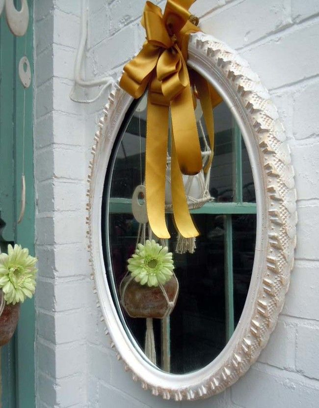 Using a bike tire, you can secure it between a mirror to create a lovely hanging mirror.
