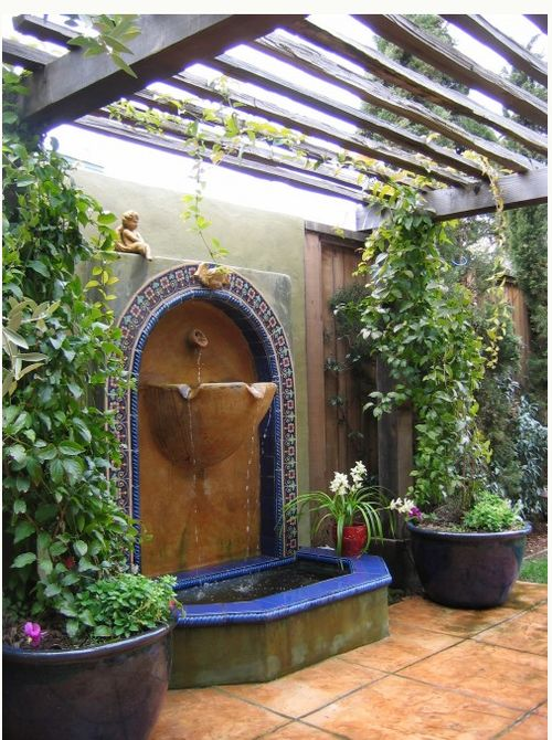 Hand painted tile fountain,  often used in courtyards of Spanish Revival architecture