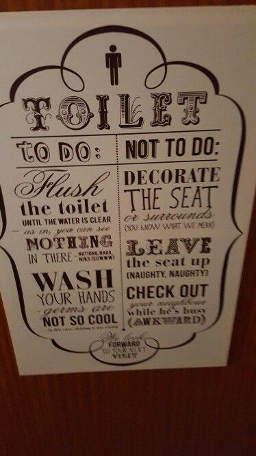 On the men's toilet door