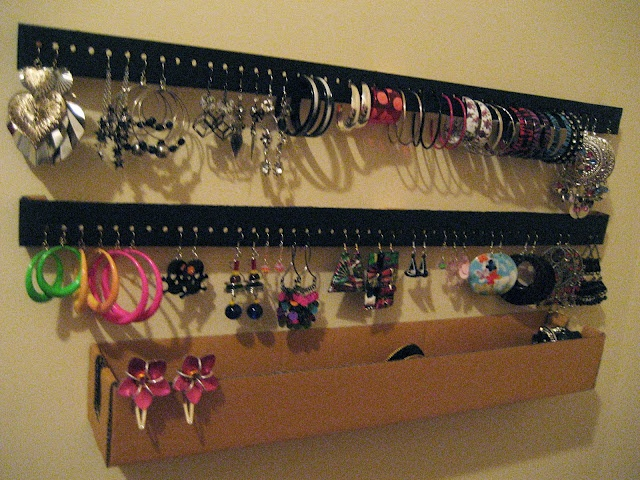 Great idea for an earring holder! Simple, inexpensive and utilizing recycled cardboard. Fantastic! Gonna do this!