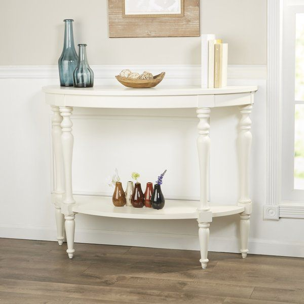 Intricately turned legs and a half-moon shape make this console table a stunning option for narrow spaces.