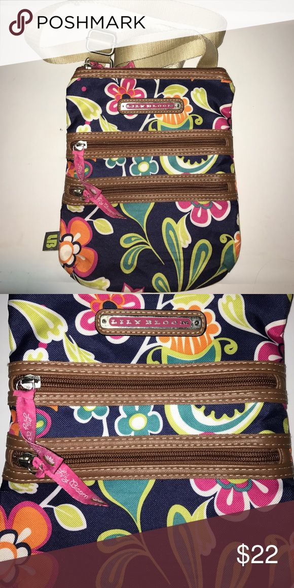 Lily Bloom Cross Body Purse Navy cross body purse with multicolored flowers. 3 different size zip pockets Lily Bloom  Bags Crossbody Bags