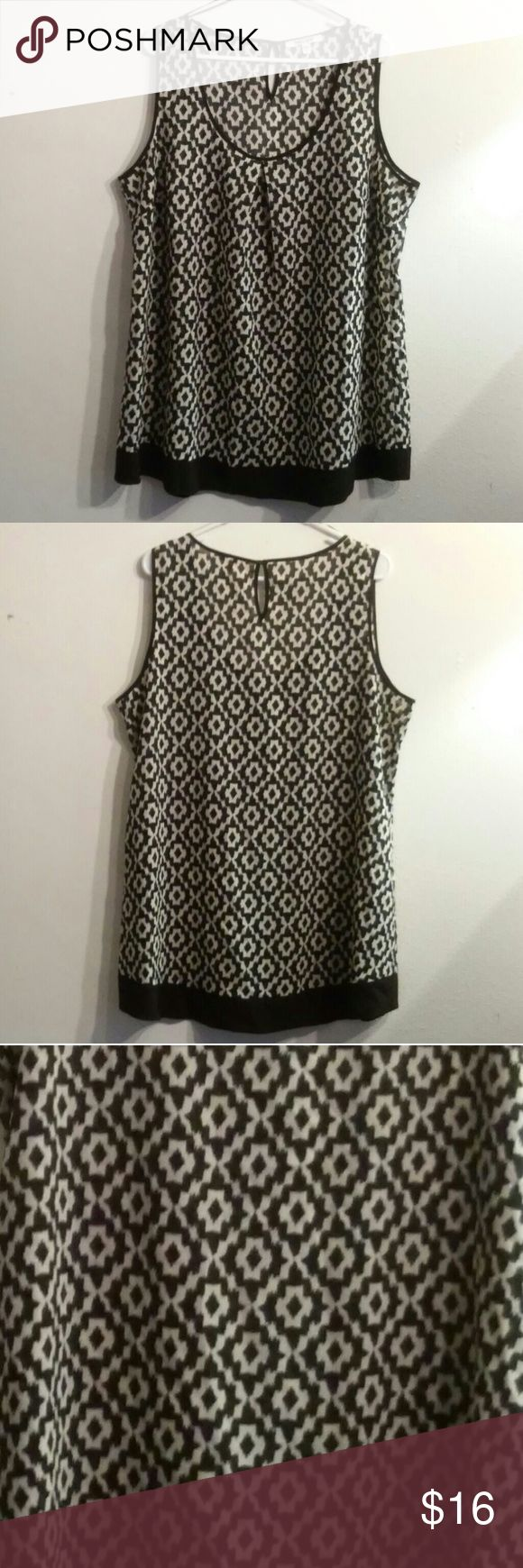 """Daniel Rainn Tunic Top Sz. 1X NWOT Flowy little tunic top from Daniel Rainn Sz 1x. Could be worn as a mini dress if your MY height (5'2"""") with a long cami or slip under it.  Keyhole button in back.  Back of neck to hem is 30.5"""". Bust is 25"""" side to side.  This would be super cute & easy with capris or leggings and sandals. Dress it up with heels & a long tassel necklace.  Bundle up & save on shipping! Daniel Rainn Tops Tunics"""