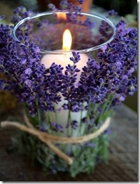 Really lovely lavender surrounding a simple white candle with tie. DIY with fresh flowers of any sort. Charming