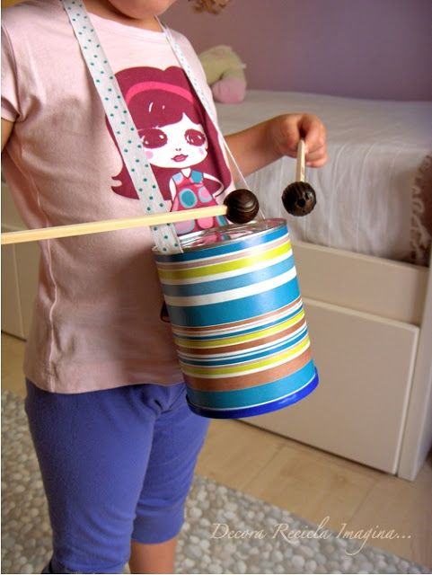 Mini tin can drums - pretty much FREE to make and would be fun to play with!  Recycled kids craft