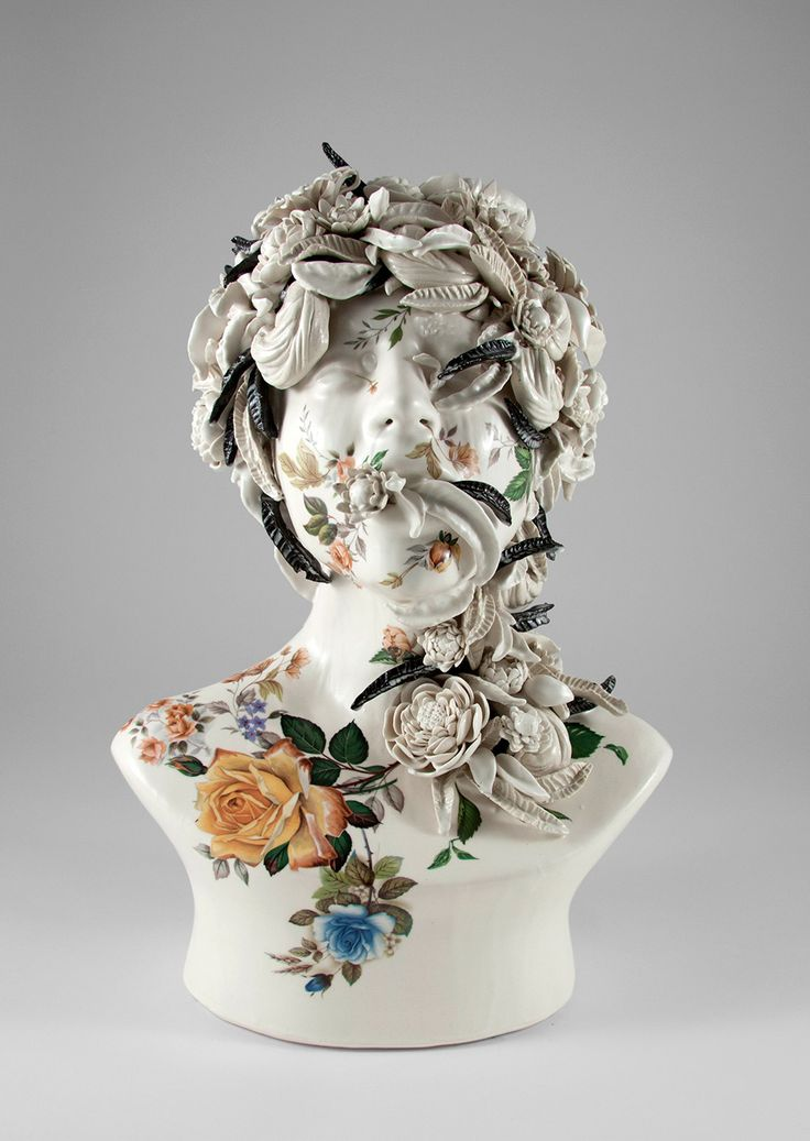 Jess Riva Cooper (previously) produces smooth ceramic busts, the mouths agape rather than closed in smile or silent contemplation. Tangled vines and rosebuds sprout from their mouths, and in some cases leaves from plants pop from the busts' noses, engulfing the faces in their entirety.