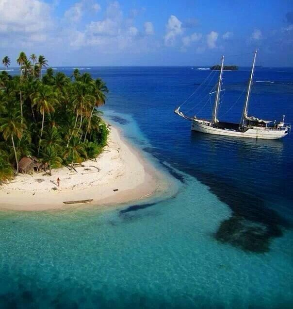 A Schooner is moored at San Blas Islands, Panama while the crew and guests explore and discover the island.