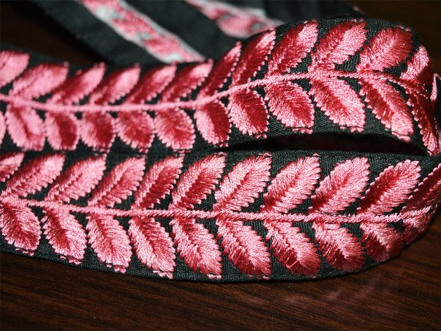 Pink Embroidered lace and border in Silk Art Thread on Black Cotton Fabric designer Lace and Trims, it is 1 inches wide.This stunning lace can be used for designing stylish blouses, shrugs, skirts,...