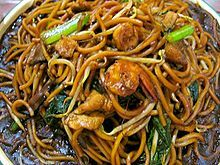 Chow mein 1 by yuen.jpg  (HY) Chow mein is a stir-fried dish in Amereican Chinese cuisine that consists of noodles and meat. It is usually served at westernized Chinese resturants.