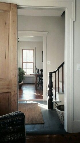 Quintessential New England home space - the light falling on all the wooden elements, the simple beautiful woodwork. The spareness.