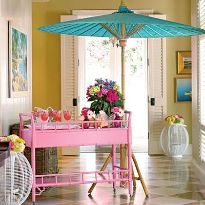 Pretty in Pink Bar Cart | Greet guests with a whimsical bar cart to set the theme for your party. This preppy pink station is decorated with fresh flowers and accented with a bright blue parasol. | SouthernLiving.com