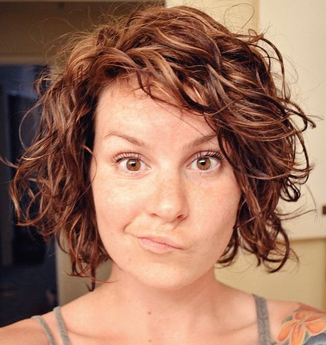 Styling naturally wavy hair.  I kinda like her cut....am I brave enough to go that short?