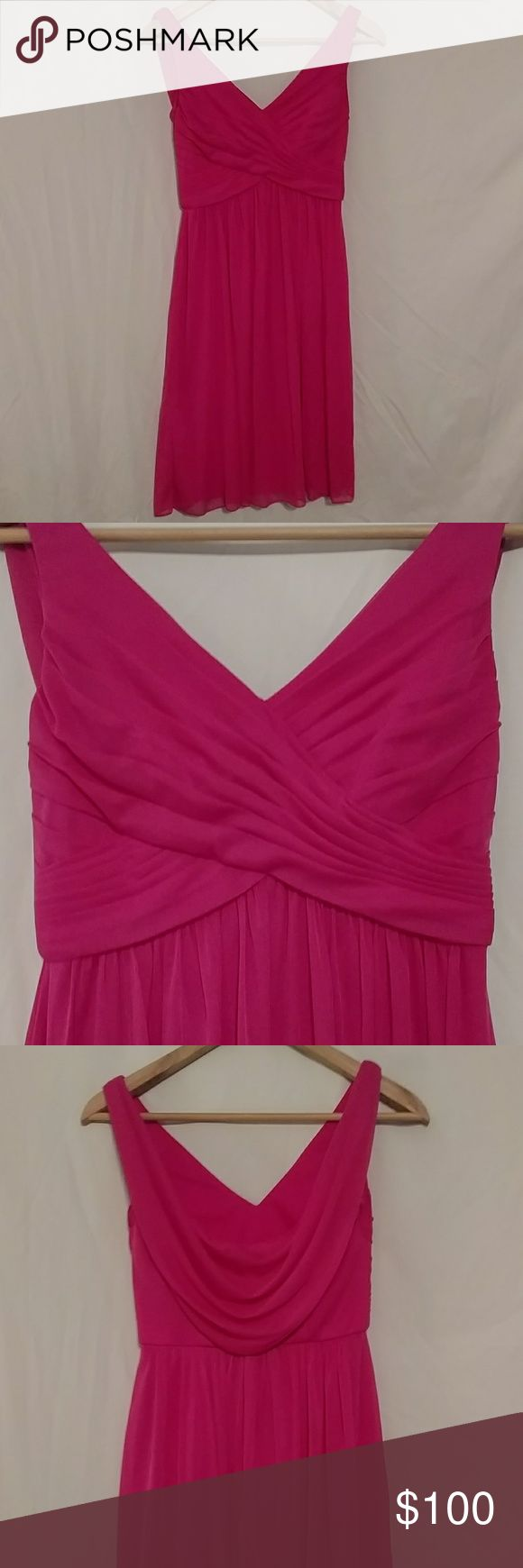 Bridesmaid dress Begonia colored knee length dress. Even hem at the bottom and pleasing fit at the waist when on. Back has a drape attached to cover the zipper. Front has a cross shape over the chest. Worn once David's Bridal Dresses Wedding