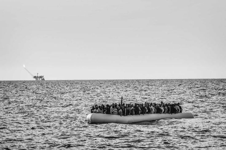 Contemporary Issues, 2nd prize stories. Libyan migrants being rescued by the international medical relief organization Doctors Without Borders in the Mediterranean Sea.<br><br>In this photograph, an overcrowded rubber dinghy sails from Libya to Italy, Strait of Sicily, Mediterranean Sea, Aug. 26, 2015.