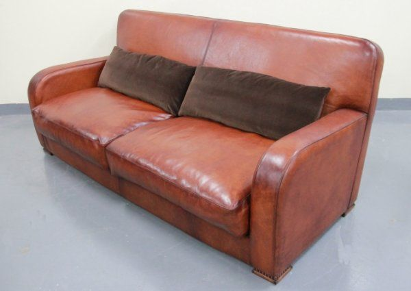 Tetrad Strand Sofa, coming to Bell Northampton January 2014. Hardwood frame, feather and foam cushions, with antique leather.