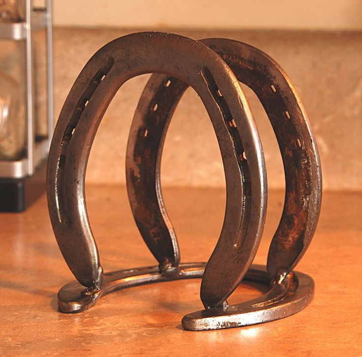 Western Decor Napkin Holder. Good idea for a book holder if horse shoes were welded properly together.