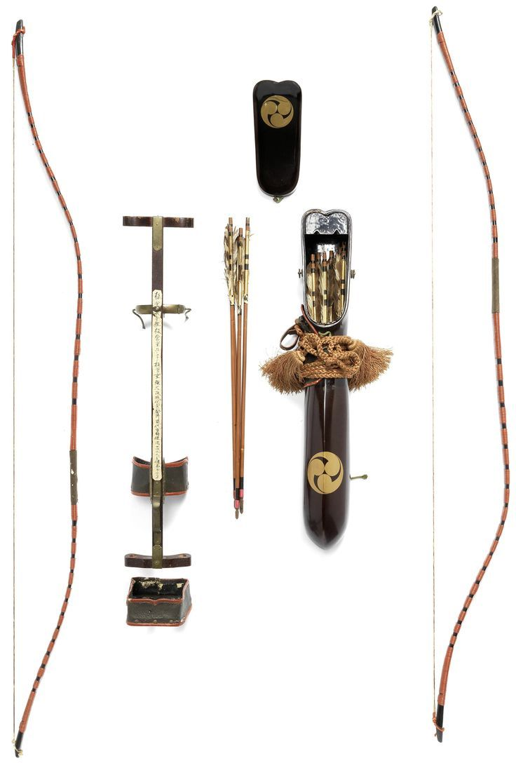 Yumi-dai (archery stand) comprising a wooden shaft with brass and tooled leather mounts, with two bows of black lacquer bound with red-lacquered rattan bands, 119.5cm (47in); the utsubo (quiver) of roiro, lacquered in gold hiramakie with mitsu-tomoe mon containing ten bamboo-shaft arrows with gold and black lacquer details.  About mid-19th century, Japan