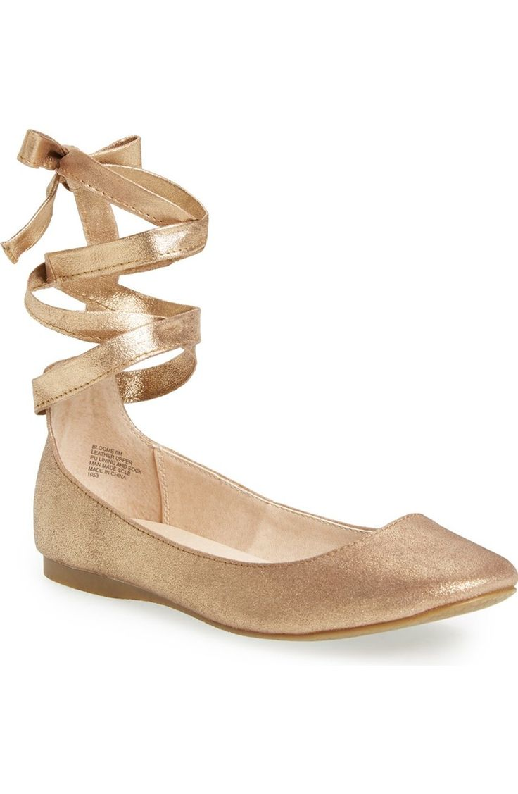 Have fallen head over heals for these golden ballet inspired flats, ribbon laces and all.