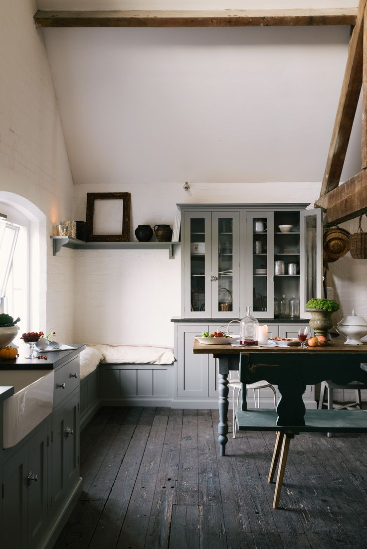 Mixing old and new with simple deVOL Shaker cupboards and an antique table and bench.