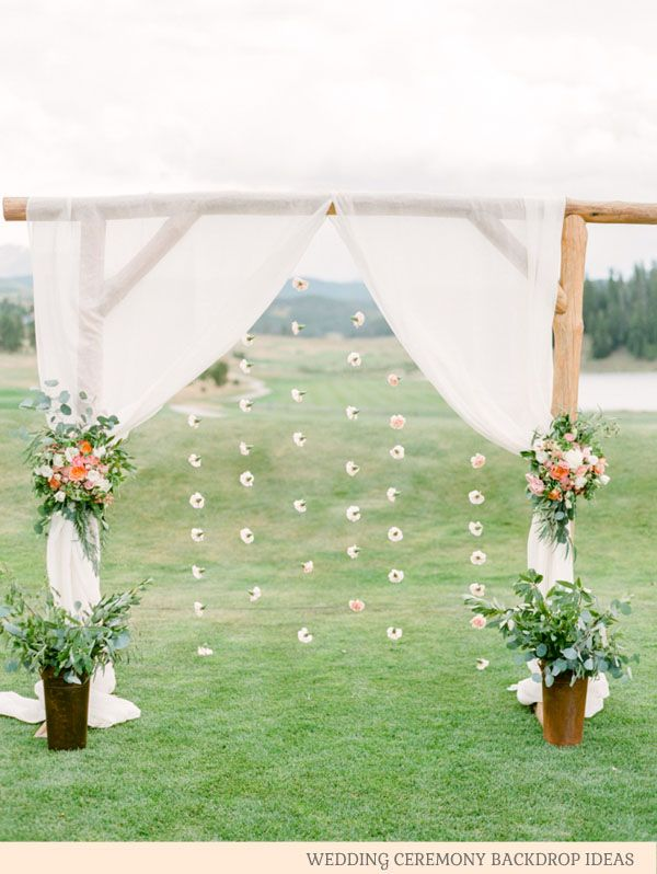 curtains and stings of cotton flower heads - wedding ceremony backdrop ideas by @theweddingomd