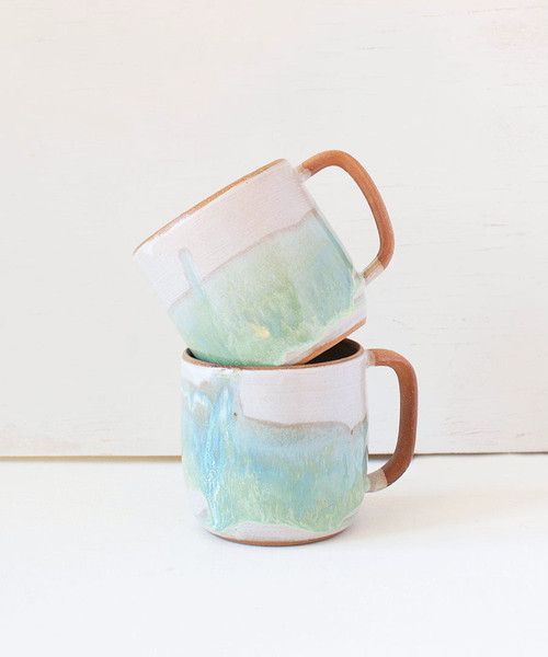 Backordered, will ship in 4-5 weeks Add this gorgeous unique mug to your collection or gift it to a special friend. It's pretty enough to stare at and functional enough to use everyday! Wheel-thrown r