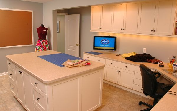 Basement craft room by Neals Design Remodel.  Perfect! Put laundry space on wall where caulk board is and have countertop overhang on one side.