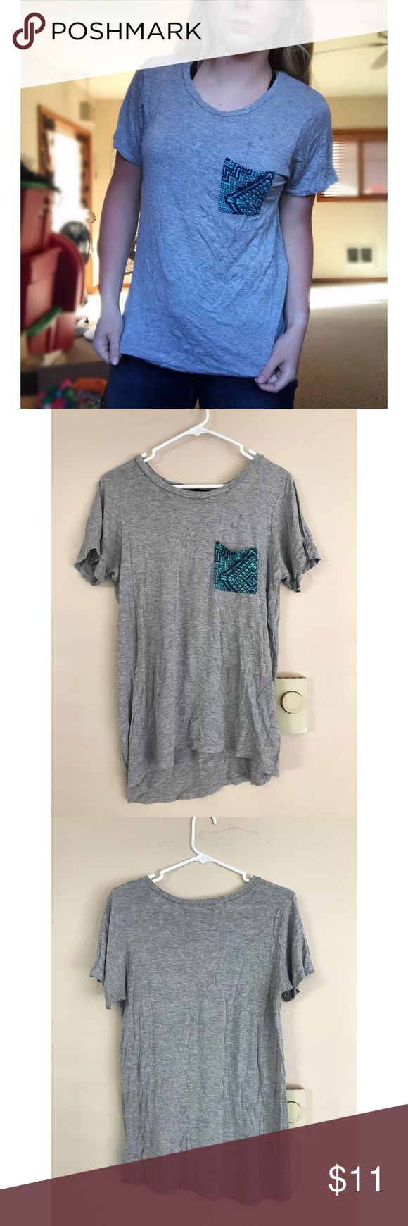 Grey tshirt w design pocket. Workshop. Size M. -Brand: Workshop -What is it?: T-shirt -Material:  Cannot read tag -Special Features   •lightweight  •stretchy  • Front pocket -Size: M -Color: Gray -Used -Flaws: Couple of dark spots above the pocket Ask if any questions!  Measurements:  Bust (underarm to underarm) =  17.5 inches Sleeve Length (from middle of back to end of sleeve) =  13 inches Length (from bottom of collar to bottom of hem) = 24 inches workshop Tops Tees - Short Sleeve