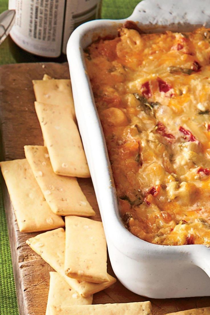 Baked Tex-Mex Red Pepper Cheese Dip | Kick off game day with a baked dip that's sure to score major points. Whether you're planning a watch party at home or setting up the tent on campus this Saturday, your tailgate spread is always in need of a good dip. Just as portable as they are easy to pull together, dips are a cinch to bake-and-take just about anywhere your alma mater pride takes you. From a flavorful gumbo dip full of Louisiana pride to a creamy crab dip that tastes as though it's…
